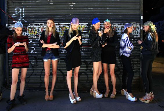 Models wait outside during a walkthrough before the Edun Spring 2011 collection show during New York Fashion Week