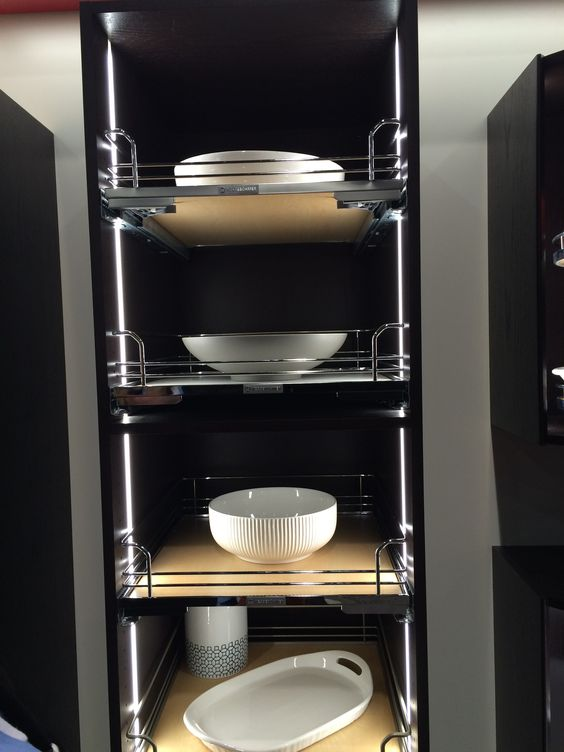 Fully outfit a pantry with chrome and woodgrain roll-out trays and don't forget the motion activated LED lighting- Hafele