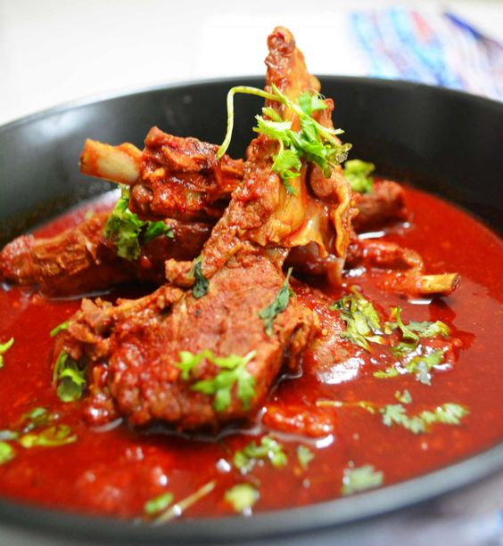 Enjoy Rajasthani Laal Maas with hot Phulkas, steamed rice or Baati. It is usually made during special occasions and festivals in Rajasthan.