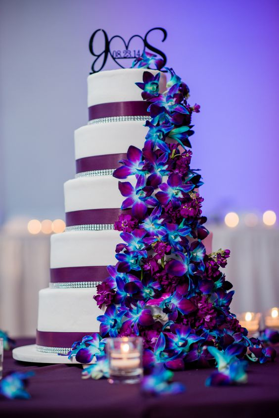 Our wedding cake.  Purple / Plum theme with dendrobium   orchids dyed blue and a few lisianthus filler flowers.