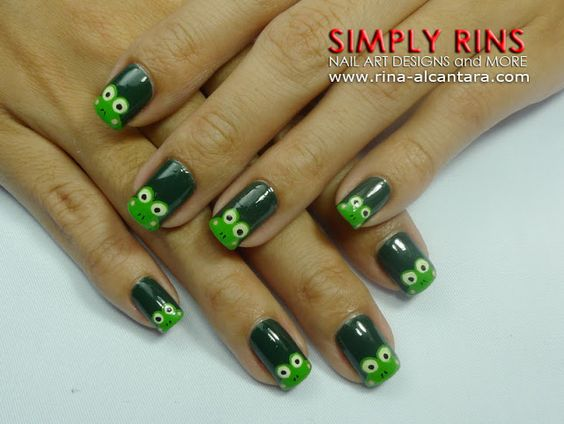 """Keroppi or Frog Nail Art Design by Simply Rins. """"Base color is 2 coats of Orly Enchanted Forest...All the frogs were painted using acrylic paint."""""""