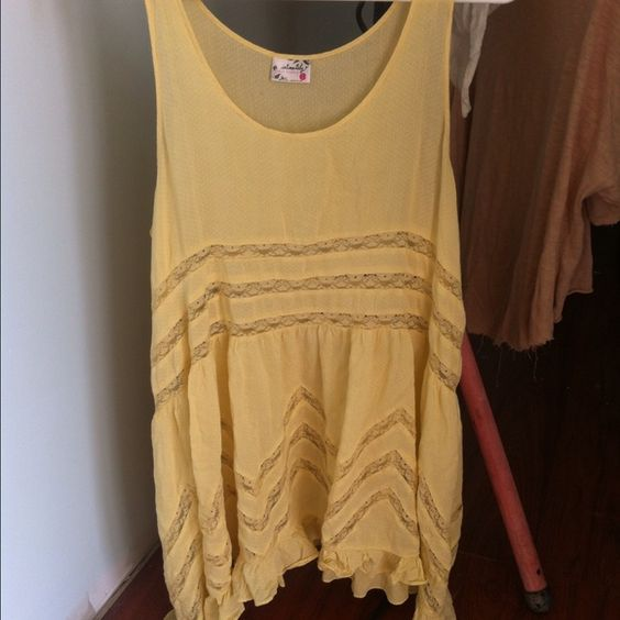 Free people slip A classic slip from free people in a soft yellow color Free People Dresses