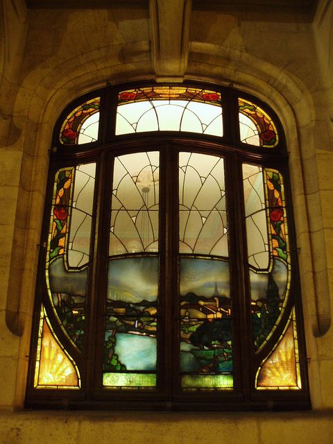 One of a series of Art Nouveau windows decorating a 1900s bar in Nancy.