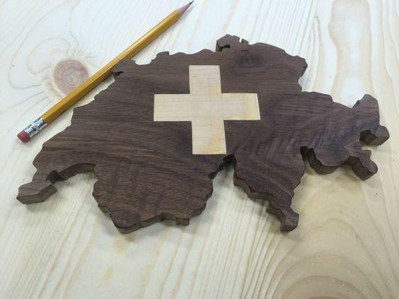 Switzerland scrolled in Walnut with a maple Swiss Cross inlay.