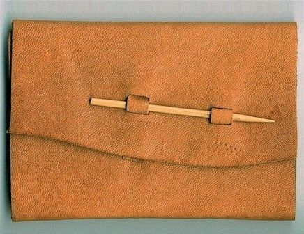 Limp leather binding. Closure with bamboo rod