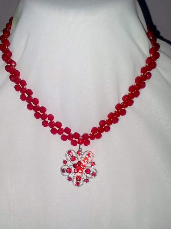 Right angle weave Swarovski beaded necklace with red rhinestone and silver pendant by sassybeadedjewelry. Explore more products on http://sassybeadedjewelry.etsy.com