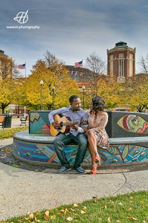Navy Pier Engagement Session in Fall Chicago area Toby singing for Ola yellow trees around Navy Pier in background  Photo by Doru Halip for http://www.h.photography
