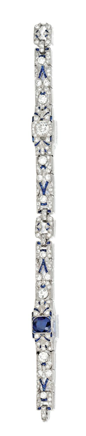 PLATINUM, SAPPHIRE AND DIAMOND BRACELET, CIRCA 1920 The ornate openwork links set with a cushion-shaped sapphire weighing approximately 2.50 carats, and an old European-cut diamond weighing approximately .95 carat, set throughout with old European-cut and single-cut diamonds weighing approximately 5.50 carats, accented by calibré-cut sapphires, length 7¼ inches, maker's mark, numbered 1604, one small diamond and one sapphire missing.