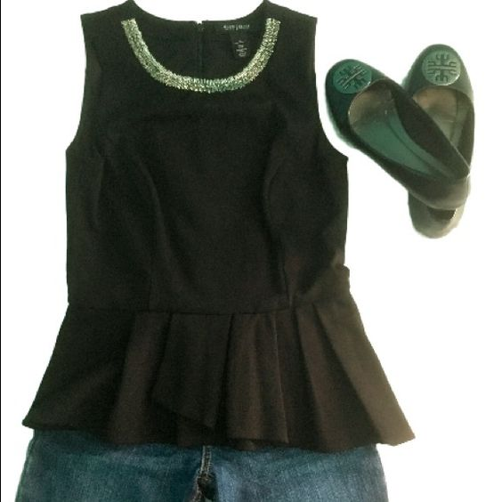 Black peplum top WHBM This shirt is really cute and has a sparkly neckline as well as an asymmetrical peplum bottom. Looks really cute with jeans or leggings. Materials: 70% viscose, 25% polyamide, 5% elastane.  Make me and offer through the offer button.  White House Black Market Tops Tank Tops