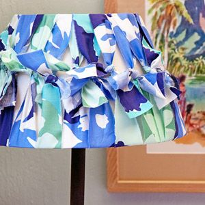 Dress up a lamp shade with old t-shirts, pillowcases, sheets, etc.