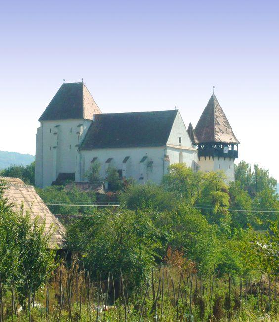 The fortified Lutheran Church of Baaßen/Banza, Transylvania, Romania.