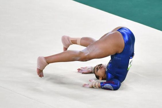 Great Britain gymnast Elissa Downie injures herself as she competes in the floor exercise.  Photo by Kevin Dietsch/UPI.