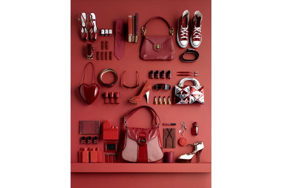 LUKE KIRWAN | This red-on-red display is simple in layout but bold in it's color.  Paint a backdrop & highlight everyday items in one color to recreate this look!