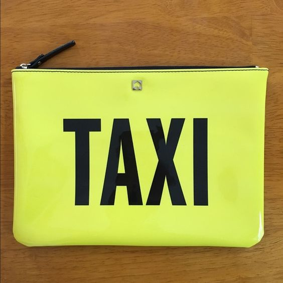 Kate Spade Taxi Clutch  Adorable clutch from Kate Spade! I bought this a few months ago and used it once, trying to get rid of some of my bags! Make me any reasonable offers  kate spade Bags Clutches & Wristlets