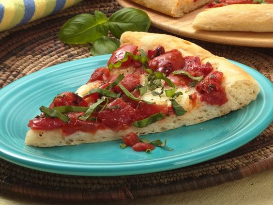 Pizza Margherita - had this tonight with our own vine-ripened tomatoes & fresh basil... with my own pizza crust recipe - just the best.
