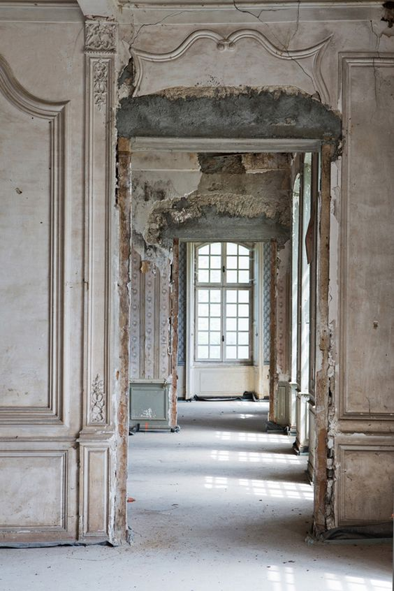 Romantic French chateau with crumbling, distressed, weathered walls of paneling and exquisite architecture. Photography by Carla Coulson for Harper's Bazaar. Weathered Walls & Déshabillé Lovely. #French #chateau #oldworld #distressed #walls #weathered #decay #restoration