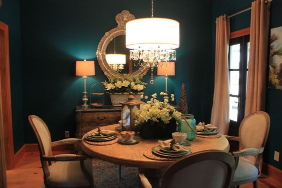Dining Room. Pedestal Table, French Country Chairs, linen curtains, Peacock Blue / teal paint, mixed dinnerware. It took forever but I love it!