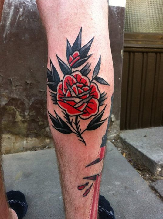 Old School Rose Tattoo Traditional Style Black And Red Rose Tattoo On The Calf Traditional Rose Tattoos Traditional Tattoo Neck Tattoo