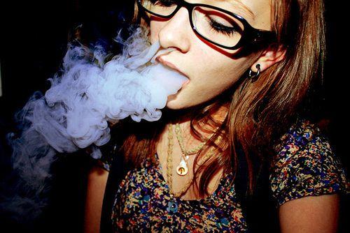 Girl Blowing Cannabis Smoke