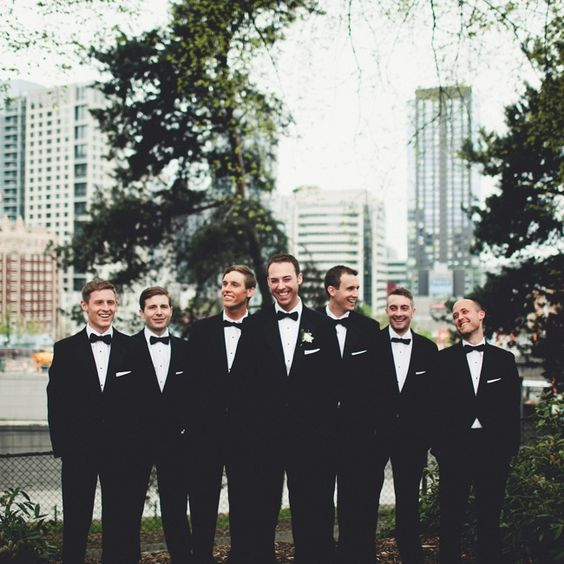 Groomsmen Wore Traditional Black Tuxedos With Matching Black Bowties Groom Only With