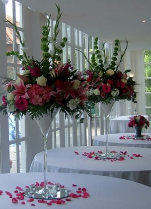 """Wedding Flowers """"An elegant Martini vase display creates an exquisite centrepiece for your wedding reception tables. Pretty bloomy vintage displays of two tone and pale pink hydrangeas, pink and ivory larkspur, scented stocks, ivory Avalanche roses, pale pink Sweet Avalanche roses and Nakuru roses, and champagne pink lisianthus.  Ask your wedding florist about vase hire. """""""