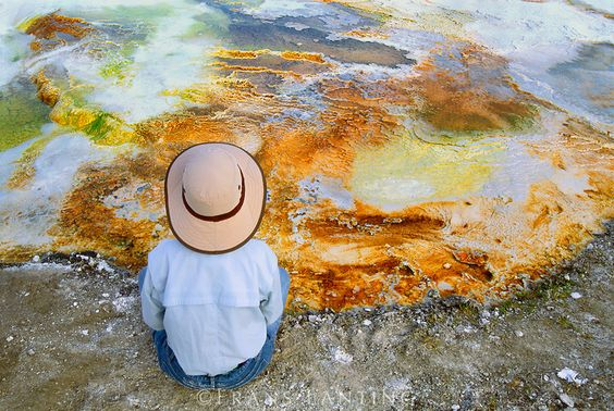 Frans Lanting - Visitor at edge of hotspring, Yellowstone National Park, Wyoming
