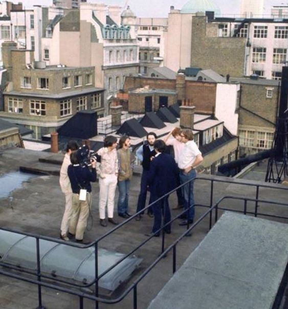 On the roof waiting On Apple rooftop before the stage was ready in January 1969... Paul, Ringo, Mal, Glyn Johns and Director Michael Lindsay-Hogg.