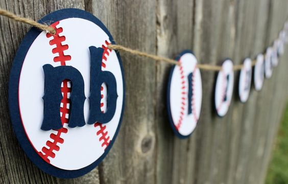 This nb to 12 first year photo banner is perfect to display your lil' slugger's first year photos. The navy blue, red and white cardstock quality is absolutely amazing. Each baseball measures approxim