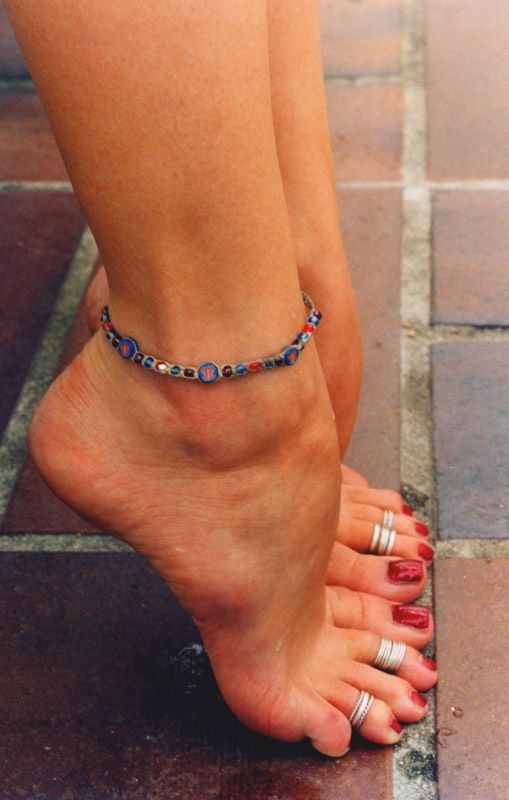 I wear four toe rings (two on each foot) all the time. I never take them off. And during the summer I'll add others.