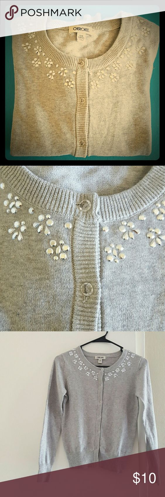 CHEROKEE GIRLS CARDIGAN NEVER WORN Pretty and classic! This cardigan has never been worn.  It's a light Heather gray with clear buttons down the front and embellished with silver flower designs across the neckline. This is a size large 10/12 purchased from Target. Cherokee Shirts & Tops Sweaters