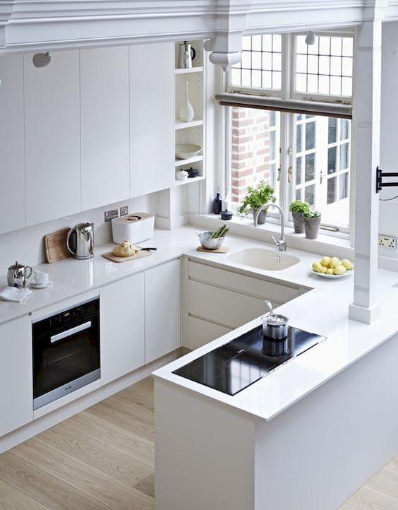 White Minimalist Kitchen With Sleek Cabinets Kitchen Design Small Small Kitchen Decor Kitchen Design