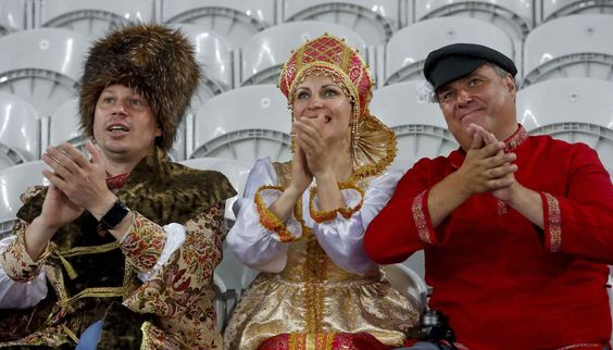 Russian supporters, wearing traditional dresses, applaud as they wait for the start of the Euro 2016 Group B soccer match between Russia and Slovakia at the Pierre Mauroy stadium in Villeneuve d'Ascq, near Lille, France, Wednesday, June 15, 2016. (AP Photo/Michel Spingler)/FP101/238520060972/1606151437