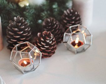 Warm up the Christmas table with this geometric candle holder and make it sparkle! Turn this piece to a beautiful light source only with a small tealight candle, and enjoy the ambient light added to your holiday table. For a rustic display, sprinkle pine cones and pods amidst the candles, pair silver and gold accents with rustic, found objects and a bouquet starring wintry garden picks alongside blooms.  This listing comes with one icosidodecahedron shaped glass item which is particularly…
