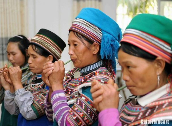 Hani women take part in a rehearsal for a folk music performance to celebrate the International Women's Day on March 8 in Yuanyang County, southwest China's Yunnan Province