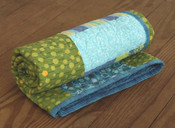 Modern aqua baby quilt. Colors include blue, aqua and green.