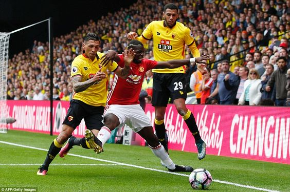 Pogba receives no spare change from the Watford defensive duo of Jose Holebas…
