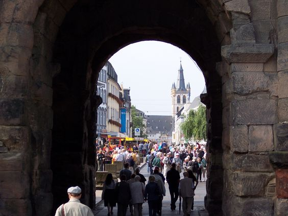Paul and Heidi entered Trier, Germany, through the ancient Porta Nigra. Trier was their last stop before getting out of Germany in Friends & Enemies.
