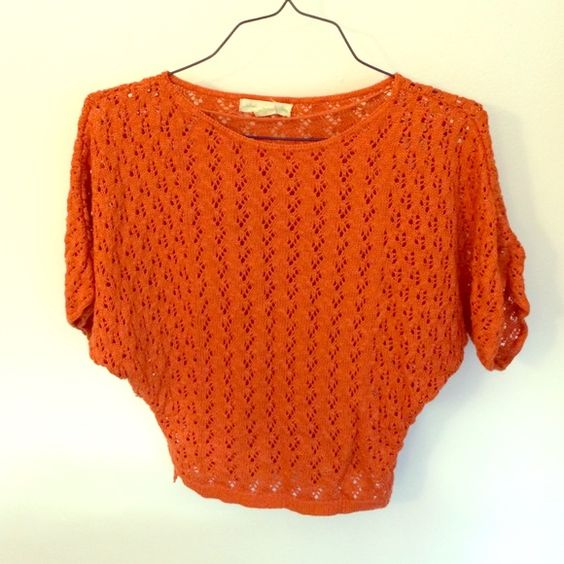 Knit top with batwing sleeves Orange knit top with batwing sleeves. Worn 2x. Semi-cropped, falls just above waist (shown in picture) Urban Outfitters Tops Crop Tops