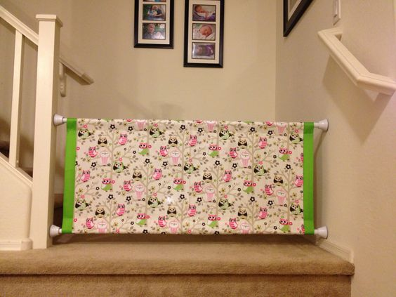 Homemade baby gate...2 shower curtain rods and fabric. Nice to ...