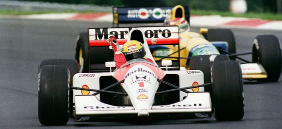 (1) Ayrton SENNA - McLaren MP4/6 Honda RA121E - Honda Marlboro McLaren leads (20) Nelson PIQUET - Benetton B191 Ford Cosworth HB - Camel Benetton Ford - VII Magyar Nagydij - 1991 FIA Formula 1 World Championship, round 10