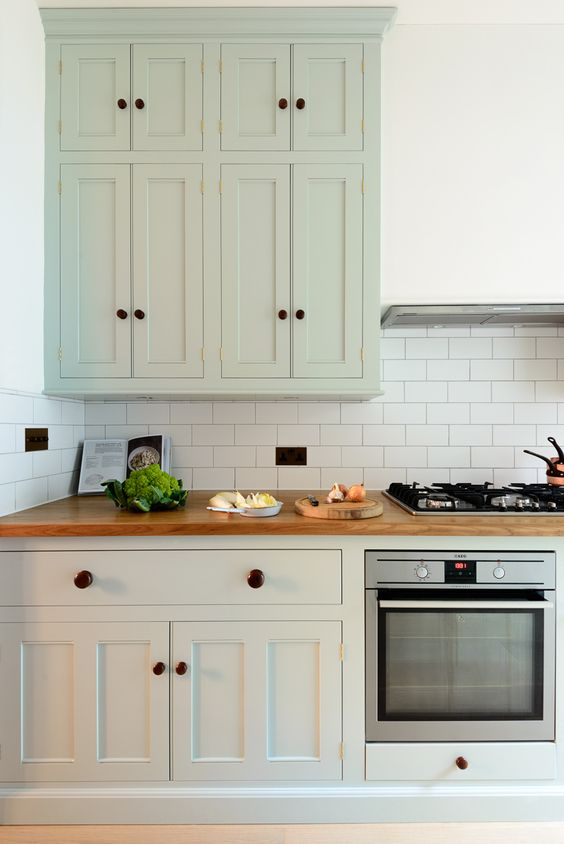 The tall bespoke wall cupboards from the classic english for Bespoke kitchen cabinets