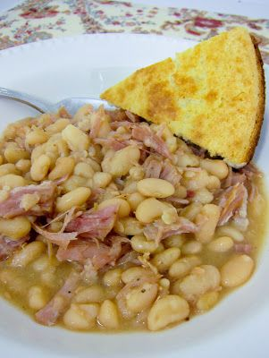 Slow Cooker Ham  White Beans 1 lb package dried northern beans ham bone, hocks, shanks or diced ham (about 1 pound) 2 tsp onion powder 6 cups water salt  pepper to taste Rinse and sort the beans for any pebbles. Add the the rinsed beans, onion powder, salt, pepper, and ham to the crock pot. Add water. Cover and cook on low about 8 hours, until beans are tender.