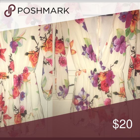 Floral romper In great condition. I actually bought on here but was too small. It is a size small but fits more like an xsmall in my opinion. Other