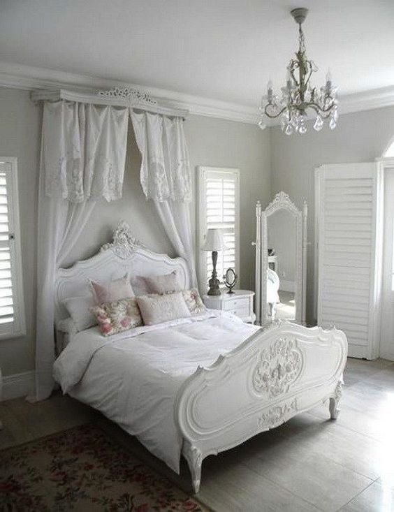 White in White Shabby Chic Bedroom with a Canopy over Headboard.