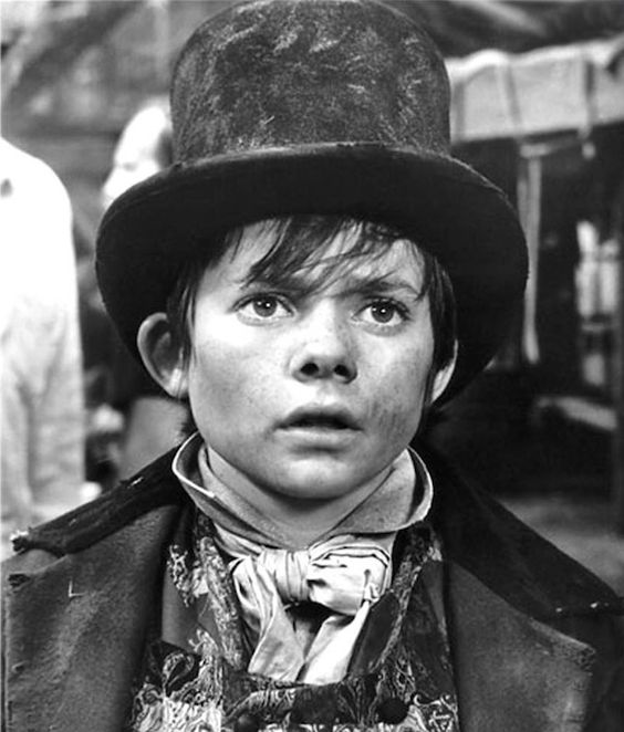 """One of my favorite literary characters is The Artful Dodger from Oliver Twist. The leader of Fagin's gang of kid criminals, the Artful Dodger is a bombastic, raggedy Peter Pan figure, who is """"as dirty a juvenile as one would wish to see"""" but with """"all the airs and manners of a man."""" And my little street urchin of a cat is named after The Artful Dodger."""