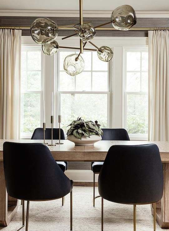Light Brown Oak Dining Table With Black Leather Chairs Brings A Modern Finish Under A Smoke Gray H Brown Dining Table Transitional Dining Room Oak Dining Table
