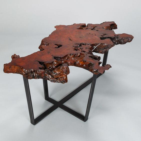 Petrified Live Edge Cocktail Table On Metal Base  --  Table was custom made using a petrified slab of live edge wood and new metal base with black finish.  --   Item:  7389  --  Retail Price:  $1695