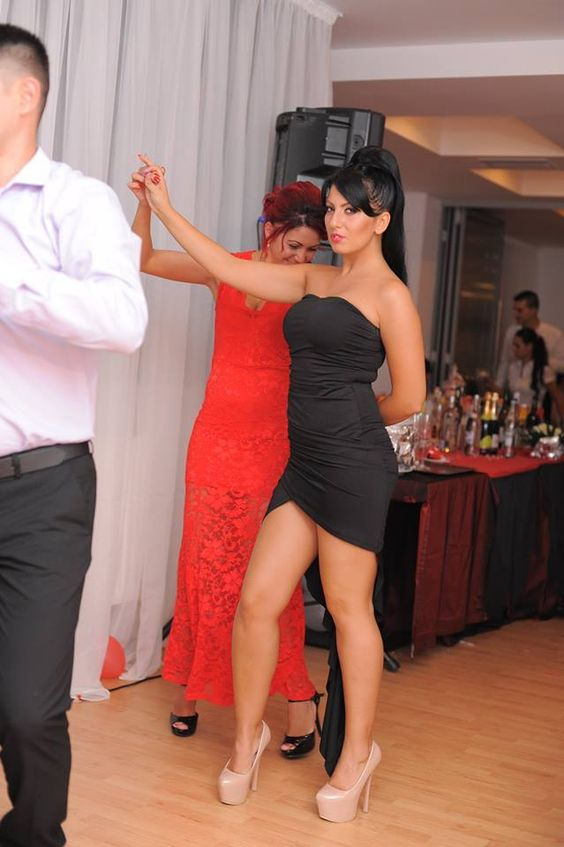 Hot pretty girl dancing in party in short gown