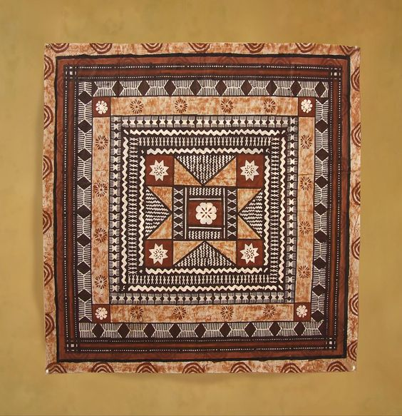 Square Masi with intricate patterns in warm color scheme.