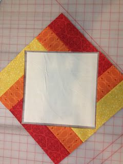 That Crazy Quilty Girl: Glorious Autumn: Pumpkin Patch(work) Tutorial--this is way simpler than I would have thought--2 3 striped squares cute and reassembled to frame a block